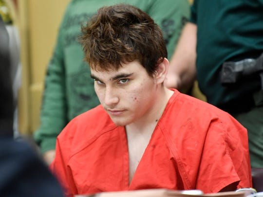In this April 27, 2018 file photo, Florida school shooting suspect Nikolas Cruz, looks up while in court for a hearing in Fort Lauderdale, Fla.