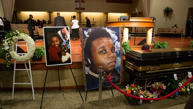 Photos surround the casket of Michael Brown inside Friendly Temple Missionary Baptist Church awaiting the start of his funeral on August 25, 2014, in St. Louis Missouri.