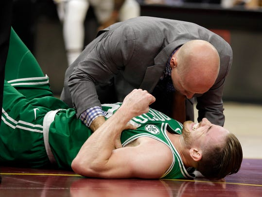 Boston Celtics' Gordon Hayward grimaces in pain in the first half of an NBA basketball game against the Cleveland Cavaliers, Tuesday, Oct. 17, 2017, in Cleveland. Just five minutes into his Boston career, new Celtics star forward Gordon Hayward gruesomely broke his left ankle, an injury that may end his season. (AP Photo/Tony Dejak)