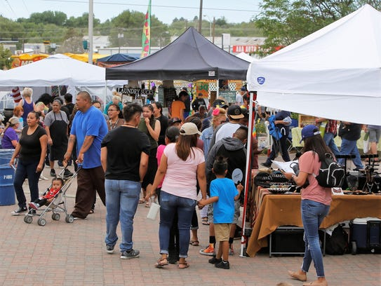 Visitors survey the food, drink and vendor offerings