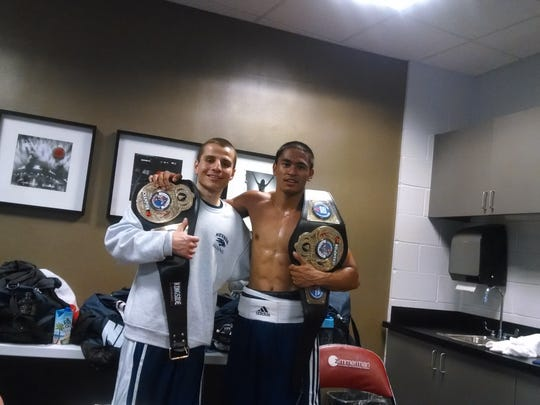 Nevada's Jarred Santos, left, and JJ Mariano won national boxing titles Sunday in Florida.