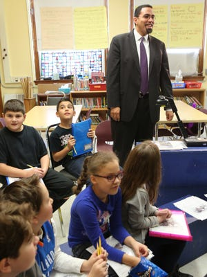 State Education Commissioner John King acknowledges his introduction by fourth-grade teacher Barbara Parmly at Putnam Valley Elementary School on Monday. He was visiting classrooms and meeting with teachers to observe and recognize their work on the Common Core standards.