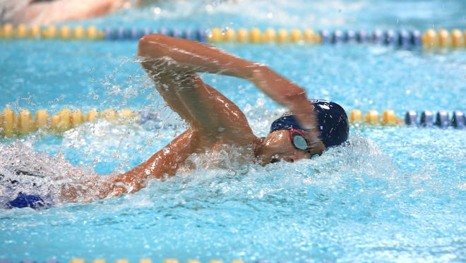 Erwin Ortiz and the Roberson boys were the team winners at Thursday night's Buncombe County swim meet.