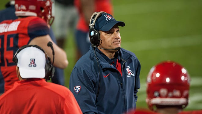 Rich Rodriguez of the Arizona Wildcats walks the field in the fourth quarter against the Colorado Buffaloes at Folsom Field on Oct. 17, 2015 in Boulder.