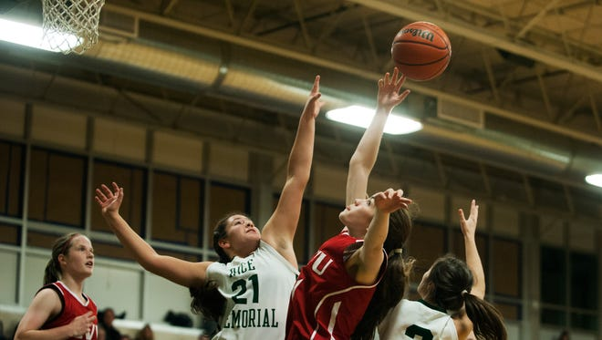 CVU's Annabella Pugliese, right, and Rice's Rachel Chicoine, left, battle for the rebound during a high school girls basketball game last week.
