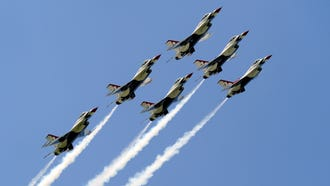 The U.S. Air Force Thunderbirds take to the air in formation.