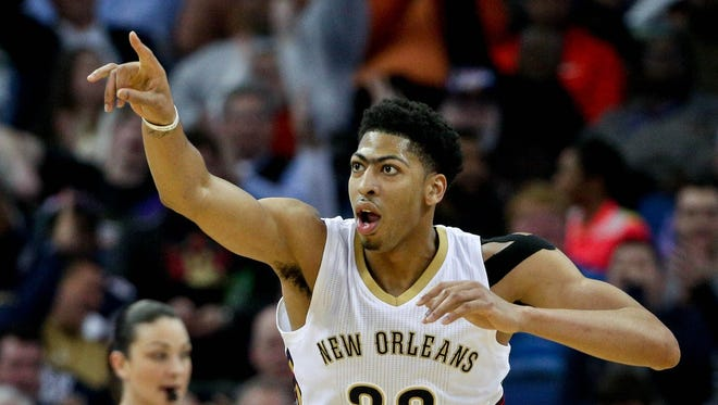 ew Orleans Pelicans forward Anthony Davis (23) reacts after a basket against the Atlanta Hawks during the third quarter of a game at the Smoothie King Center. The Pelicans defeated the Hawks 115-100.