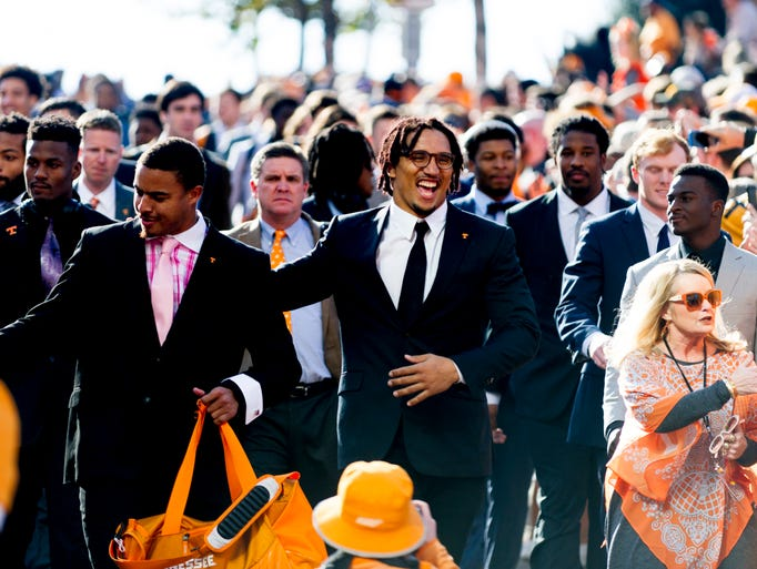 Vols arrive during the Vol Walk during a game between