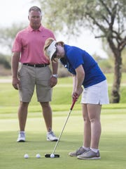 Sandra Day O'Connor's Amy Bockerstette practices with her coach, Matt Acuff, at 500 Golf Club on October 31, 2016 in Glendale, Ariz.