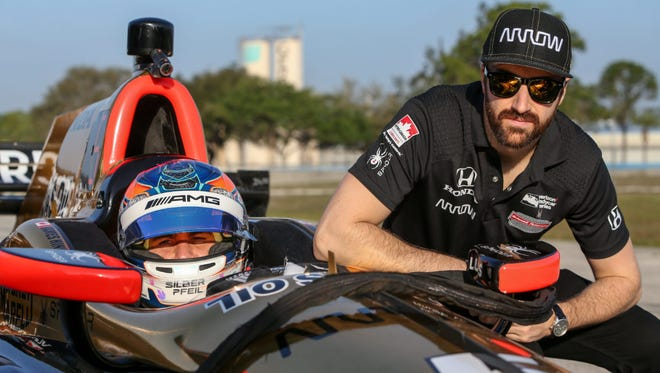 Fellow Canadians Robert Wickens (left) and James Hinchcliffe will team up for Schmidt Peterson Motorsports during the 2018 Verizon IndyCar Series season.