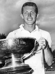Titles in the 54th annual Tri-State tennis tournament were decided on July 5, 1953 at the Cincinnati Tennis Club and Tony Trabert displays the trophy for the men's singles title he had just won.