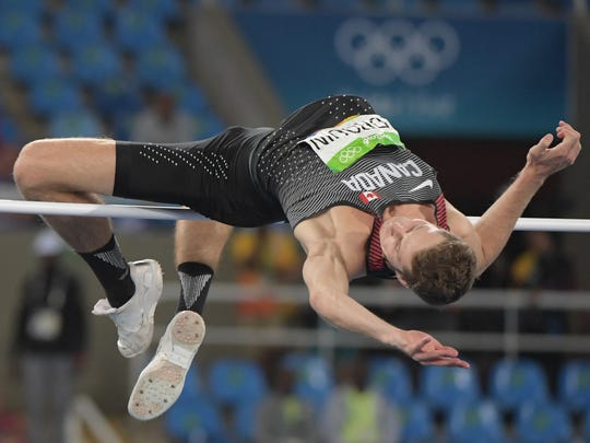 Aug 16, 2016; Rio de Janeiro, Brazil; Derek Drouin (CAN) competes in men's high jump finals during track and field competition in the Rio 2016 Summer Olympic Games at Estadio Olimpico Joao Havelange.