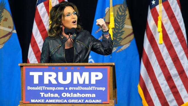 Former Republican vice presidential candidate Sarah Palin speaks to a crowd as she introduces Republican presidential candidate Donald Trump at a rally in Tulsa, Okla., Wednesday, Jan 20, 2016.