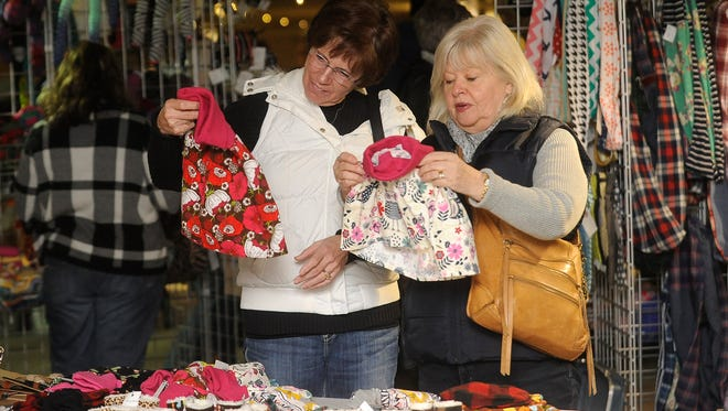 Deb Friedrich and Bonnie Steen shop Friday at the Sioux Falls Made Market at Cherapa Place.
