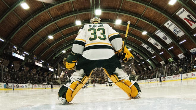 Catamount goalie Packy Munson (33) in goal during the men's hockey game between the Colgate Raiders and the Vermont Catamounts at Gutterson Field House on Wednesday night in Burlington.