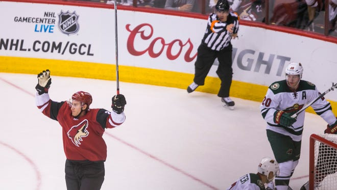 Coyotes' Michael Stone (26) celebrates after a goal against the Wild at Gila River Arena in Glendale, AZ  on October 15, 2015.