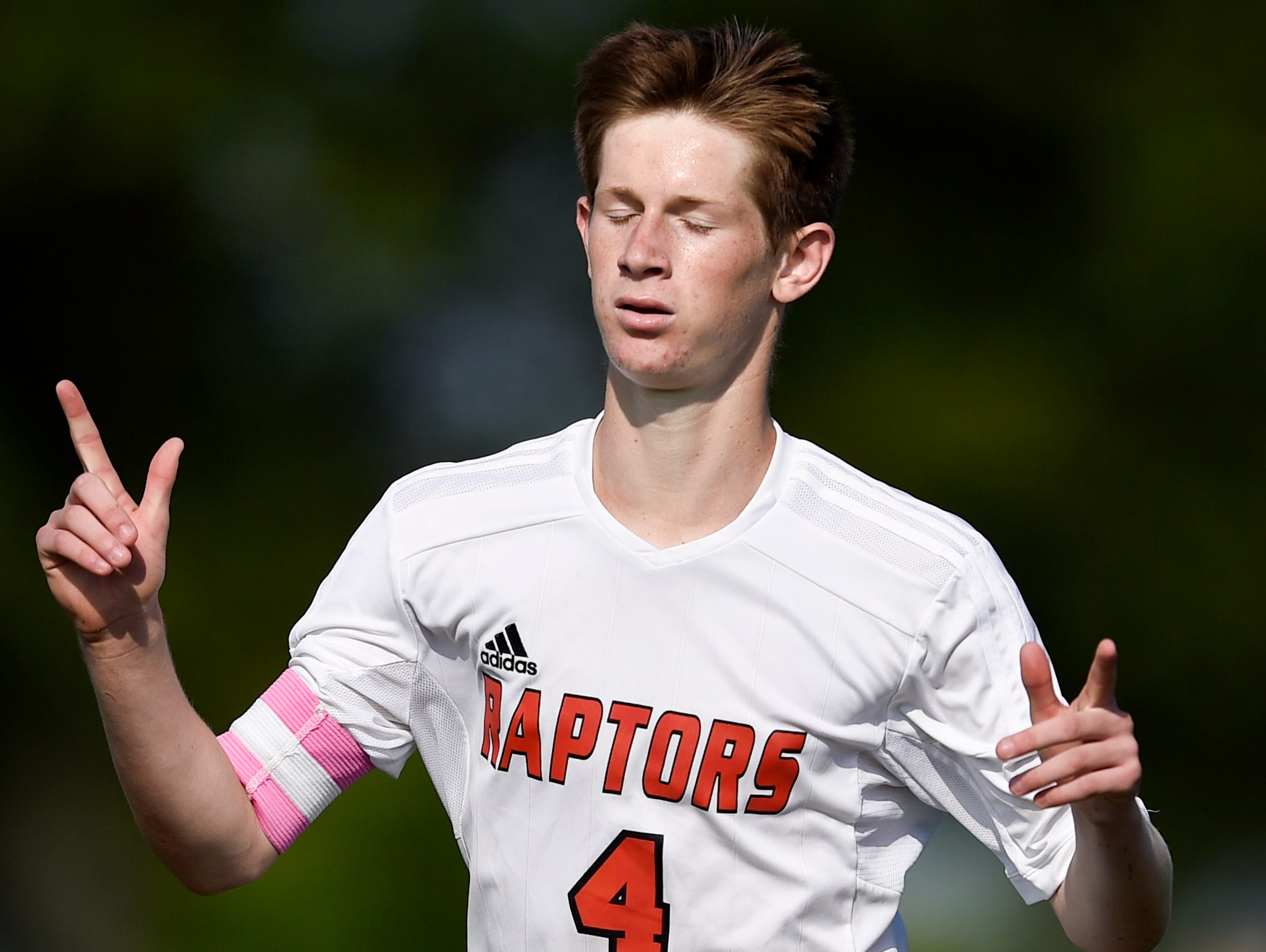 Ravenwood's Jake Hill (4) celebrates scoring against Dobyns-Bennett during the second half at the Siegel Soccer Complex on Tuesday.