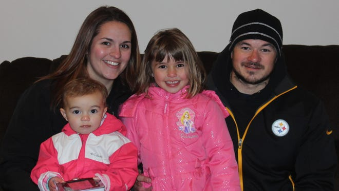 The Stinson Family - Tesa, 19- month-old Rylee, 5-year-old Olivia, and Zach