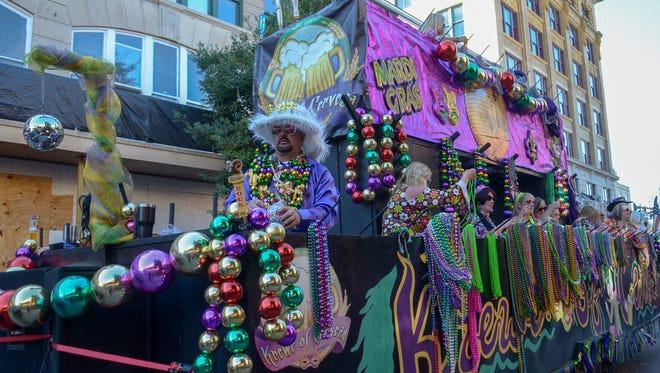 The Pensacola Grand Mardi Gras Parade rolls through downtown Pensacola last year.