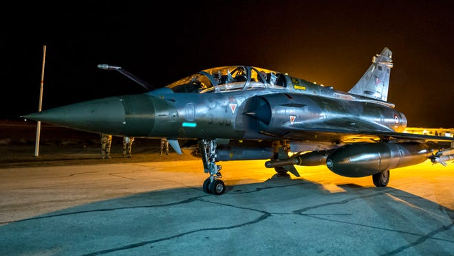 This photo released on Monday, Nov. 9, 2015 by the French Army Communications Audiovisual office (ECPAD) shows a French army Mirage 2000 jet on the tarmac of an undisclosed air base as part of France's Operation Chammal launched in September 2015 in support of the US-led coalition against Islamic State group. France's defense ministry says that a French airstrike has targeted an oil center controlled by Islamic State's militants in Syria as part of a strategy to cut off the group's funding resources. The two-hour operation conducted on Sunday near Deir ez-Zor, in the East of Syria, involved two fighter jets based in Jordan, the ministry detailed in a written statement.