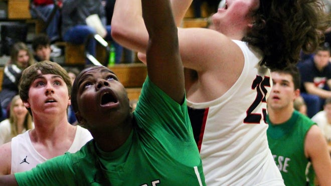 Stark County's Kane Newton (25) shoots over Wethersfield's Tevin Baker (24) on Tuesday in Toulon.