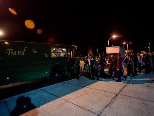 Members of the Vestal Marching Band loads the bus with their musical instruments as they prepare to head to Syracuse for the New York State Field Band Competition.
