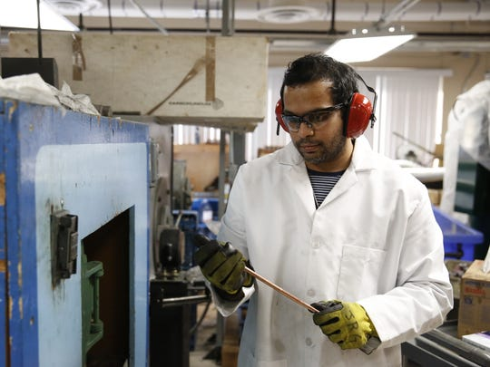 Post-doc student Shreyas Balachandran works on fabricating a wire from superconducting materials for potential use in high-field magnets at The National High Magnetic Field Laboratory's Applied Superconductivity Center Tuesday.