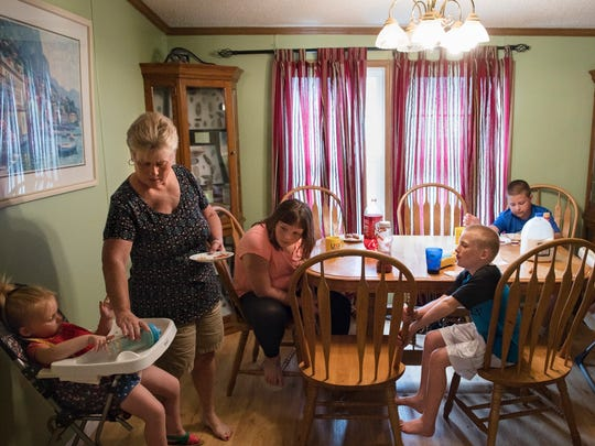 Vicki Dever feeds her grandchildren lunch in her Shepherdsville home on Wednesday, June 27.