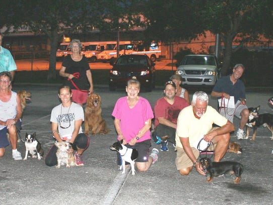 Happy dogs and owners celebrate graduation from one