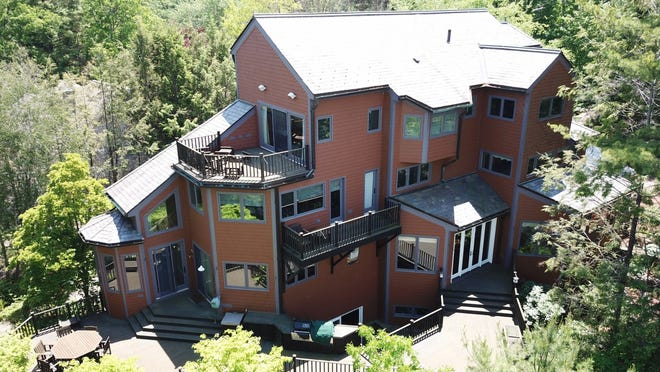 11 Bay View Road, a 9,822-square-foot, five-bedroom, six-bathroom home on Webster Lake, is listed for $2,499,900. View a photo gallery at telegram.com.