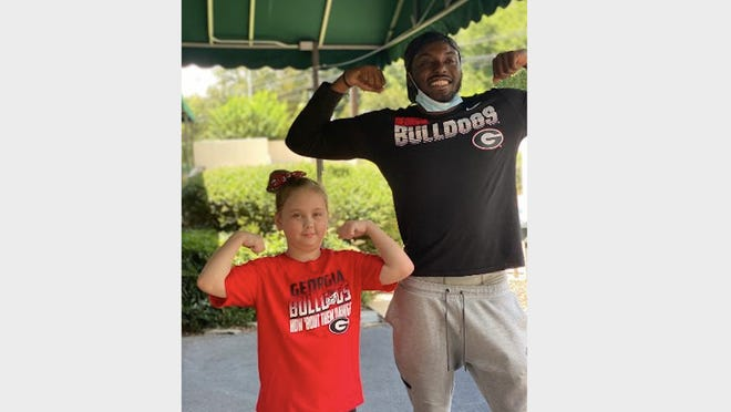 Destiny Maney and Georgia safety Richard LeCounte met in Atlanta on July 23 before the 10-year old underwent surgery.