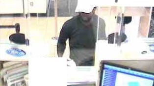 Rochester police are seeking information to help identify the man seen in this surveillance photo. Officers said he robbed a bank on Wednesday.