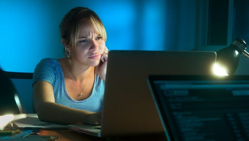 Disappointed, frustrated woman working on a computer
