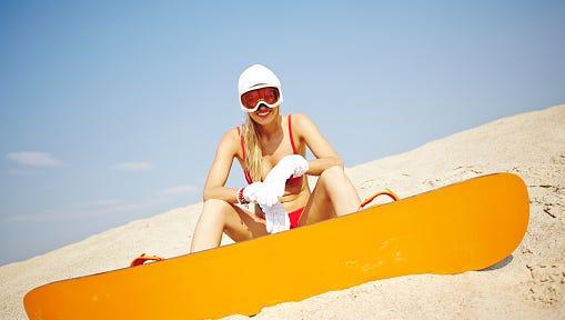Sandboarder in bikini