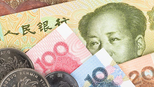 Chinese or Yuan banknotes money and coins from China's currency,