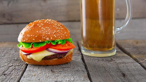 Fresh and juicy burger with a beer.