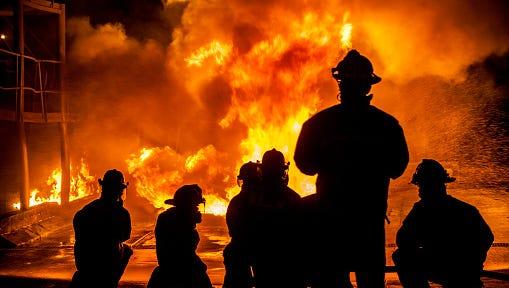 Firefighters fighting burning blaze