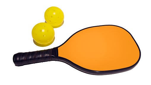 Pickleball paddle and two balls