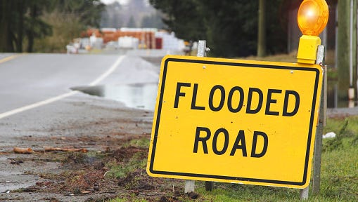 Outdoor Sign Stating Flooded Road