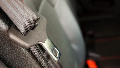 This is a close up seat belt in a modern car.