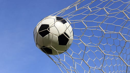Socce in the goal net