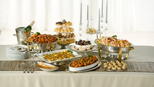 Long table with holiday buffet served