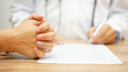 hands of Concerned Women for medical report written by doctor
