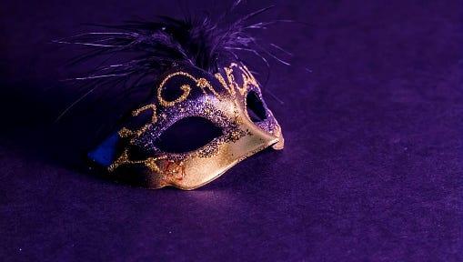Venetian Mask on Purple Background