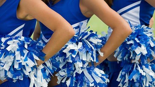Cheerleaders in Uniform Holding Pom-Poms