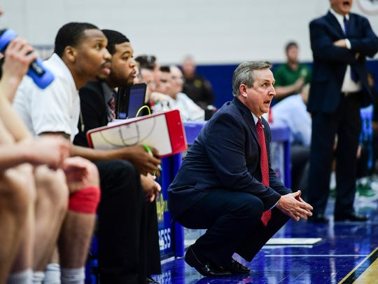 USI Head Coach Rodney Watson talks from the bench as his team takes on the Missouri Science and Technology Miners at USI's Physical Activities Center in Evansville, Ind., Thursday, Jan. 18, 2018. The Screaming Eagles defeated the Miners, 98-78.