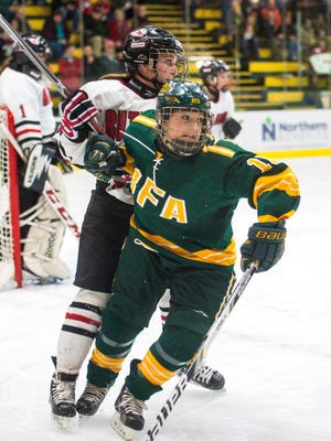 BFA's Peyton Dukas, right, and Rutland's Ella Beraldi follow the puck in the DI girls hockey state championships in Burlington on Wednesday, March 8, 2017.