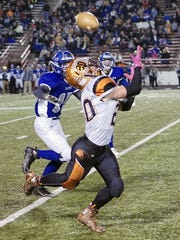 Running back Jackson Hauger attempts to haul in a pass