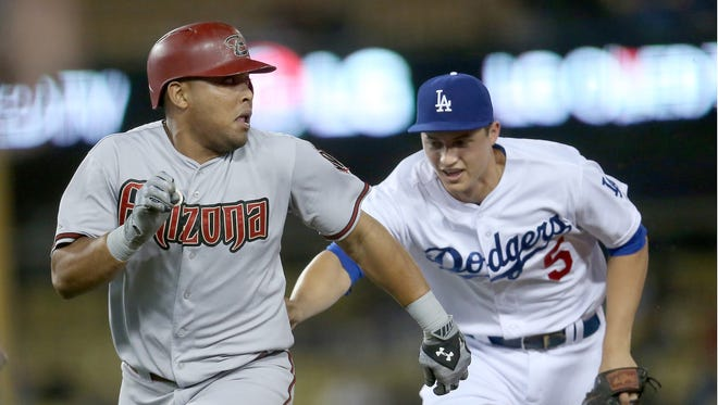 Shortstop Corey Seager of the Los Angeles Dodgers chases down and tags out Yasmany Tomas of the Arizona Diamondbacks as Tomas is caught trying to stretch a single into a double during second inning at Dodger Stadium on Sept. 22, 2015, in Los Angeles.