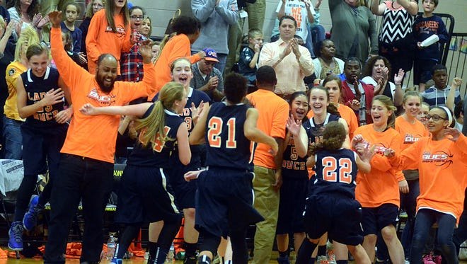 Hunter Middle School players and fans celebrate following the Lady Buccaneers' 47-43 victory on Monday evening that clinched the Sumner County Conference regular-season championship.